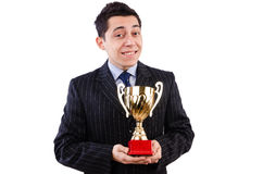 Man awarded with cup Stock Photos