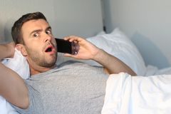 Man in awe after hearing some news.  stock photo
