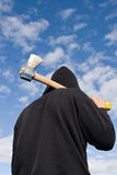 Man with axe. Man in balaclava with an axe on sky background Royalty Free Stock Photos