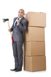 Man with axe and boxes Stock Image
