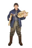 Man with an axe and cordwoods Royalty Free Stock Images
