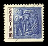 Man with axe and fettered beast. SWEDEN - CIRCA 1967: stamp printed by Sweden, shows picture an man with axe and fettered beast with a bird`s head, series iron Stock Photos