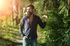 Man with axe outdoor Royalty Free Stock Images