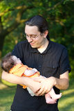 Man with Baby. A Man holding a young baby Stock Photography