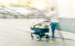 Man with baby carriage Stock Photos