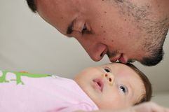 Man and baby closeup portrait. Indoor portrait with happy young famil and  cute little babby Stock Image