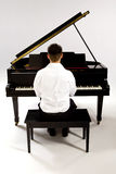 Man at baby Grand piano Royalty Free Stock Images