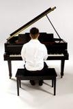 Man at baby Grand piano Royalty Free Stock Images