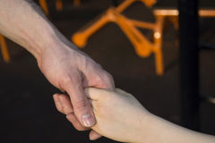 Man and baby holding hands Stock Photo