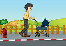 A man and baby pram Royalty Free Stock Photos