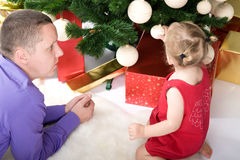 Man with baby under christmas tree Royalty Free Stock Photo