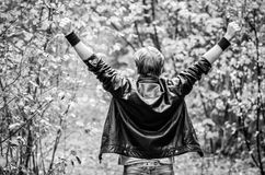 man back, hands up in forest Royalty Free Stock Images