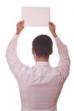 Man back holding blank paper Stock Images
