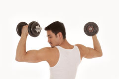 Man from back lifting weights looking shoulder Royalty Free Stock Photos