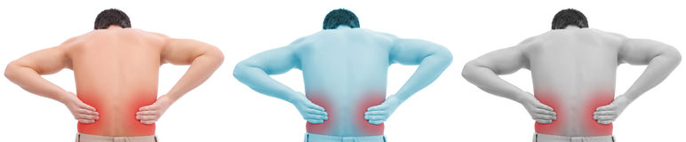 Man with back pain. Photo of a man with his hands on his back Royalty Free Stock Photo
