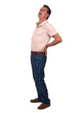 Man with Back Pain. Full Length Portrait of Middle Age Man with Back Pain wearing Casual Clothes Stock Photo