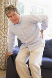 Man With Back Pain. A Man Standing With Back Pain Royalty Free Stock Image