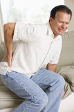 Man With Back Pain. A Man With Back Pain Royalty Free Stock Image