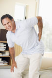 Man With Back Pain. A Man With Back Pain Royalty Free Stock Photography