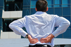 Man with back pain. Business man holding his lower back. Pain relief concept Stock Photography