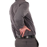Man with back pain. Holding his lower back with his hand, torso portrait isolated on white Royalty Free Stock Photo