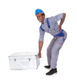 Man With Back Pain Lifting Metal Box. Young African Man With Back Pain Lifting Metal Box Isolated On White Background Stock Photo