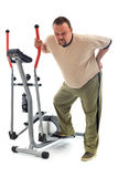 Man with back pain near a training device Stock Image