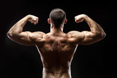 Man back shows big muscles. Stock Photo