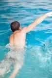 Man back swimming Stock Photos