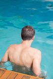 Man back swimming Stock Images