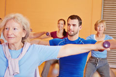 Man in back training class in gym Stock Image