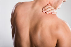 Man With Backache. Close-up Of A Shirtless Man With Backache Stock Image