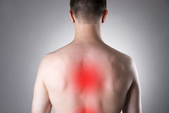 Man with backache. Pain in the human body Stock Photography