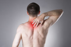 Man with backache. Pain in the human body Royalty Free Stock Photos
