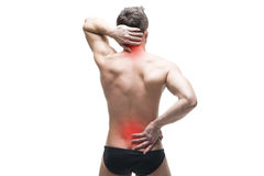 Man with backache. Pain in the human body. Muscular male body. Isolated on white background. With red dot Stock Images