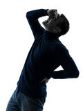 Man backache pain silhouette full length Royalty Free Stock Photo