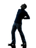 Man backache pain silhouette full length Stock Images