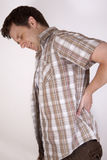 Man with backache Stock Image