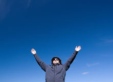 Man on background blue sky Stock Photos