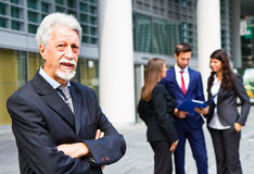 Man on the background of business people Stock Photos