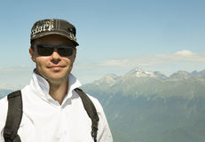 Man on background of Caucasus mountain range Stock Image