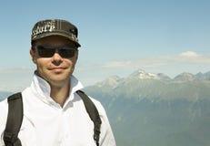 Man on background of Caucasus mountain range. In Krasnaya Polyana Stock Image
