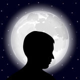 Man in the background of the full moon Royalty Free Stock Photo