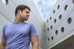 Man on the background of a modern concrete building Stock Image