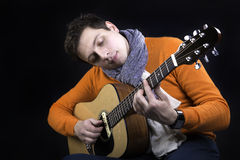 Man on background play on guitar. Stock Photo