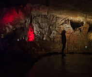 Man on the background of the Prometheus cave in Georgia Stock Photography