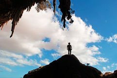 A man backlight at the entrance of Dogub cave, Socotra island, Yemen, 4x4 excursion, joy, happiness, freedom Royalty Free Stock Image