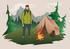Man with backpack on the background of the mountain landscape. Fire and tent. Mountain tourism, hiking, active outdoor. Happy young man with backpack on the Royalty Free Stock Photos