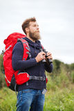 Man with backpack and binocular outdoors Royalty Free Stock Photo