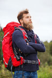 Man with backpack and binocular outdoors Royalty Free Stock Photos